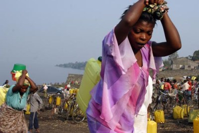 Women carry jerry cans of water in north Kivu, eastern DRC