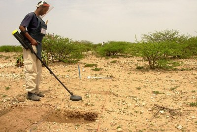 A de-mining official uses a metal detector to check for landmines in Somaliland.
