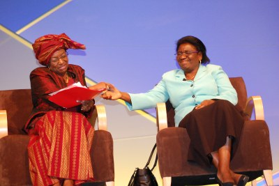 Malawi Minister of Trade and Industry Eunice Kazembe (right) congratulates Dr. Jennifer Riria (left) on her impassioned speech on behalf of women's empowerment.