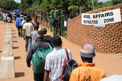 Zimbabwe asylum seekers queue outsdie the home affairs for pre-registration with the UNHCR at the Musina showground