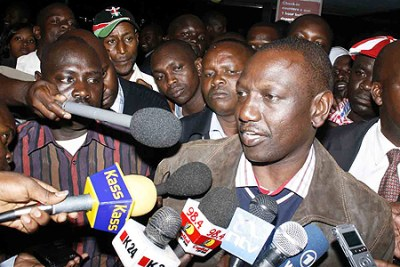 Suspended Higher Education Minister William Ruto addresses the media at the airport before his departure. He is responding to summons to appear at The Hague.