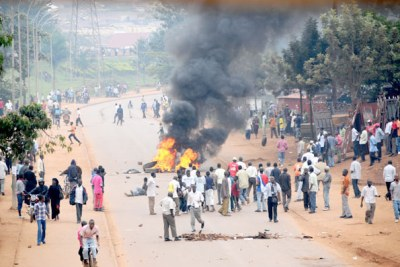 Protesters burn used tires in the middle of Entebbe road.