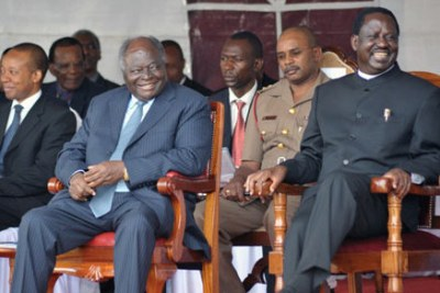 President Mwai Kibaki (left) and Prime Minister Raila Odinga (right).