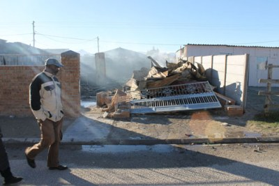 A destroyed house (file photo): The site of families fighting for their homes has touched a chord for many South Africans.