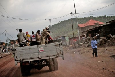 Congolese Red Cross team collecting dead bodies drive through rebel-held Goma.