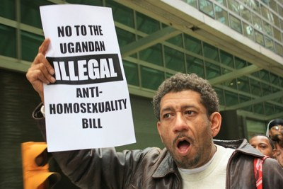A protester holds up a sign at a rally against Uganda's Anti-Homosexuality Bill.