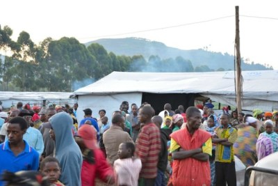 Refugees who early arrived in the morning from the DR Congo''s North Kivu region, crossing to Nyakabande Transit Centre for a better life.