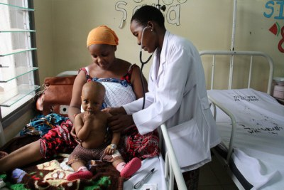 An eight-month-old boy with pneumonia is examined by a doctor (file photo).