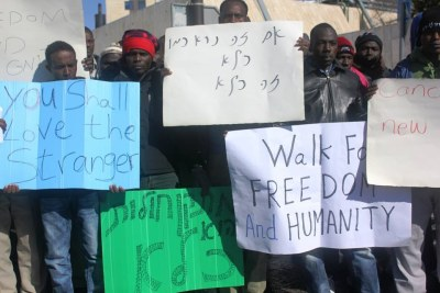 African asylum seekers demonstrating outside Israel's parliament in Jerusalem shortly before being arrested and returned to a new