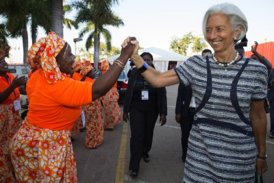 International Monetary Fund Managing Director Christine Lagarde is greeted by local singers (file photo).