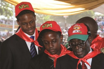 President Mugabe with his two sons (file photo).