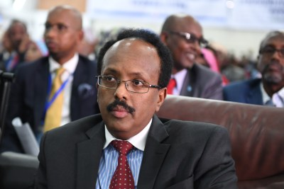 Mohamed Abdullahi Farmajo listens keenly as members of the Presidential Elections Committee count ballots cast during the presidential election at the Mogadishu Airport hangar on February 8, 2017. Farmajo was declared the president of Somalia after incumbent Hasan Sheikh Mohamud conceded defeat.