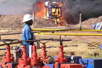 An expert watches a flaring experiment at one of the wells in the Albertine Graben. Government is looking to establish a refinery as well as a pipeline to transport oil for trade.