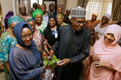 The wife of the president, Aisha Buhari welcoming President Muhammadu Buhari.