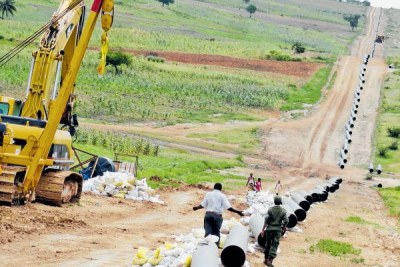 A man walks along the already set 20-inch 450km Kenya Pipeline Company [KPC} pipes at Kokotoni in this picture taken on July 15, 2015. File photo: Nation Media Group