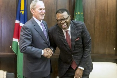 President Hage Geingob shares a laugh while hosting former U.S. President George W. Bush in Namibia.