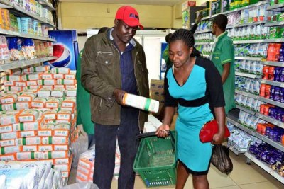A couple at the Ronald Ngala branch of Tuskys Supermarket in Nairobi purchase a packet of maize flour on May 17, 2017.
