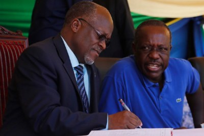 President John Magufuli and his friend energy and mineral minister Prof Sospeter Muhongo.
