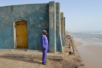 Cheikh Badiane, 54, looks out to sea from the edge of the fishing district of Guet Ndar, in the northern city of Saint-Louis, Senegal, May 1, 2017.