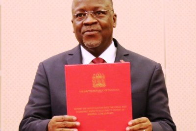 President John Magufuli displays the second report on mineral sand investigation shorlty after receiving it from the special committee he assigned to undertake the task, at the State House in Dar es Salaam.