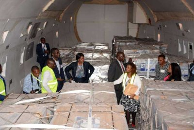 IEBC officials inspect ballot papers at the Jomo Kenyatta International Airport in Nairobi (file photo).
