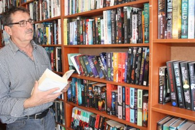 Veteran South African used book seller Eric Nofal says new titles cost too much in the country.