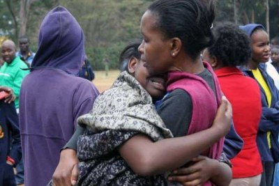 Relatives of students at Moi Girls School Nairobi in tears after a fire burnt a dormitory leaving 8 students dead and 10 others injured.