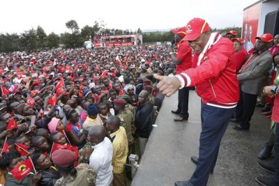 President Uhuru Kenyatta greets supporters who turned up for a Jubilee rally in Samata Nadara, Nayandarua County, on October 7, 2017.