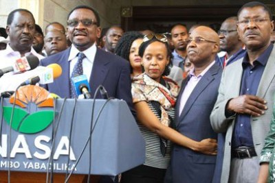 Businessman Jimi Wanjigi with his wife Irene, Nasa leader Raila Odinga (left), Siaya Senator James Orengo, Bungoma Senator Moses Wetang'ula and other legislators during a press conference at Mr Wanjigi's home in Muthaiga, Nairobi, on October 18, 2017.