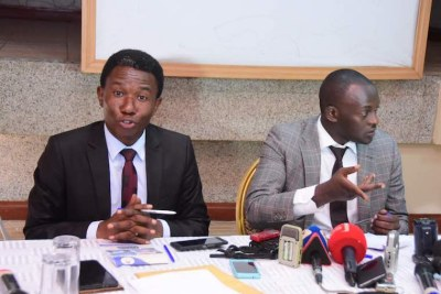 Lawyers Gawaya Tegulle (L) and Eron Kiiza address the media.