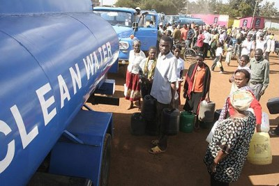 City residents queue to get water from water tankers.
