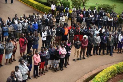 Kenya Universities Staff Union's Moi University Chapter members in Uasin Gishu County listen to secretary-general Charles Mukhwaya's briefing on April 4, 2018.