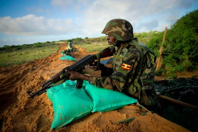 A Ugandan soldier service with the African Union Mission in Somalia stands on guard on the northern city limit of Mogadishu, Somalia.