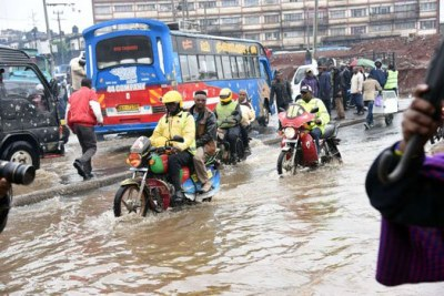 Motorcyclists ride through a flooded section of a road in Nairobi in March.