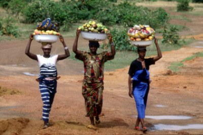 Women sell fruits and vegetables at market in Guinea Conakry