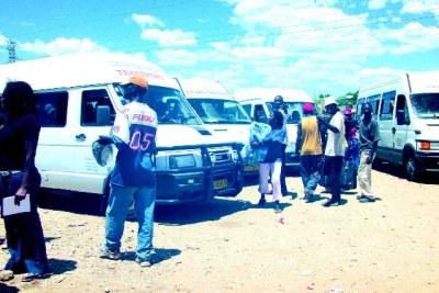 Passengers boarding a bus in Windhoek.