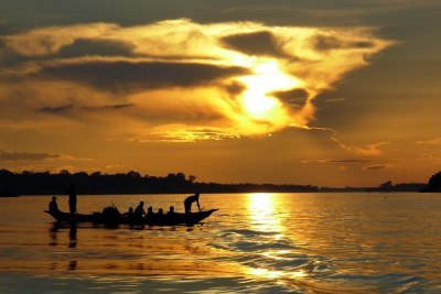 A traditional wooden boat floats on the Congo River.