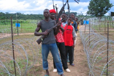 Fighters loyal to former Liberian president Charles Taylor surrender their weapons to UN peacekeepers at a disarmament camp (file photo).