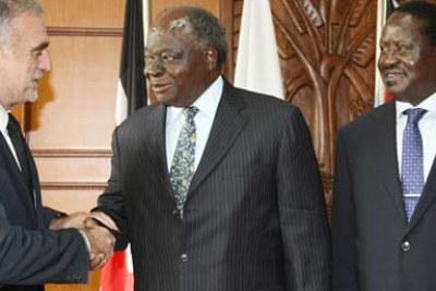President Mwai Kibaki welcomes the International Criminal Court's chief prosecutor, Luis Moreno Ocampo, in Nairobi as Prime Minister Raila Odinga looks on.
