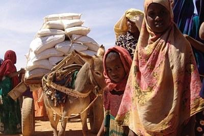 File photo: Receiving aid in Somalia.
