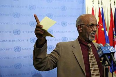 Araya Desta, permanent representative of Eritrea to the United Nations, speaks to journalists following the Security Council's adoption of a resolution imposing an arms embargo on his country.