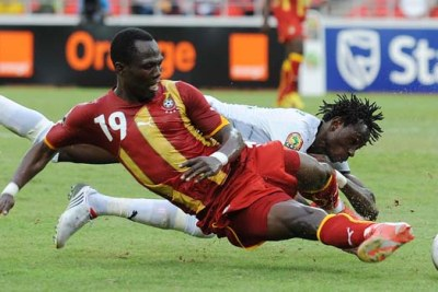 Emmanuel Agyemang-Badu of Ghana, front, clashes with Jonathan Pitroipa during the Burkina Faso-Ghana match on January 19 in Luanda.