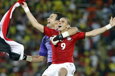 Essam Al Hadari and Mohamed Zidan of Egypt celebrate their team's victory in the 2010 Africa Cup of Nations tournament.