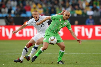 Rafik Djebbour of Algeria is challenged by Jay Demerit of United States (file photo).