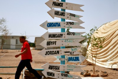 A sign points at the United Nations Mission site in Western Sahara.