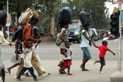A family flees the Abobo neighbourhood of Abidjan.