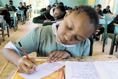 Kenya Certificate of Primary Education candidates of Moi Nyeri Complex School fill papers during examination rehearsals.