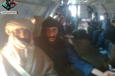 This photo is purported to show Saif al Gaddafi, left, being flown to Zintan after his capture.