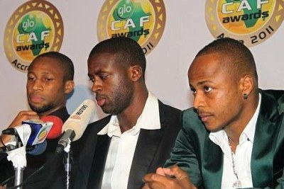 Yaya Toure of Cote d'Ivoire (centre) and Mali's Seydou Keita (left) at the CAF Awards 2011.