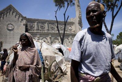 Civilians at a site for internally displaced people in the grounds of a ruined cathedral in Mogadishu in August, which was the last month that the city was attacked with mortars.